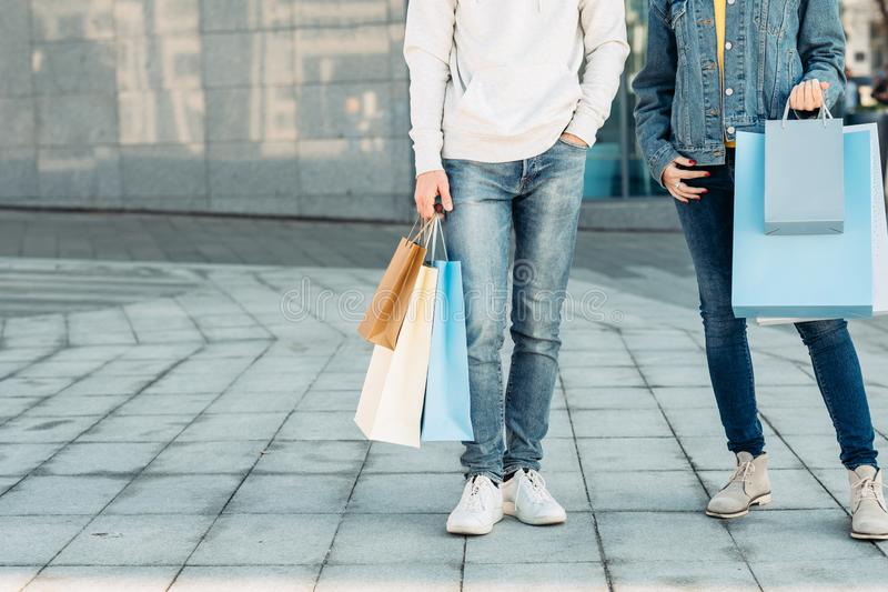 Shopping time casual leisure urban couple bags royalty free stock photo