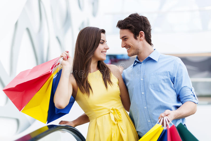 Shopping time. Conversing young couple during shopping royalty free stock image