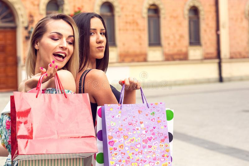 Shopping time - shopping, sale, young women in shopping royalty free stock photography