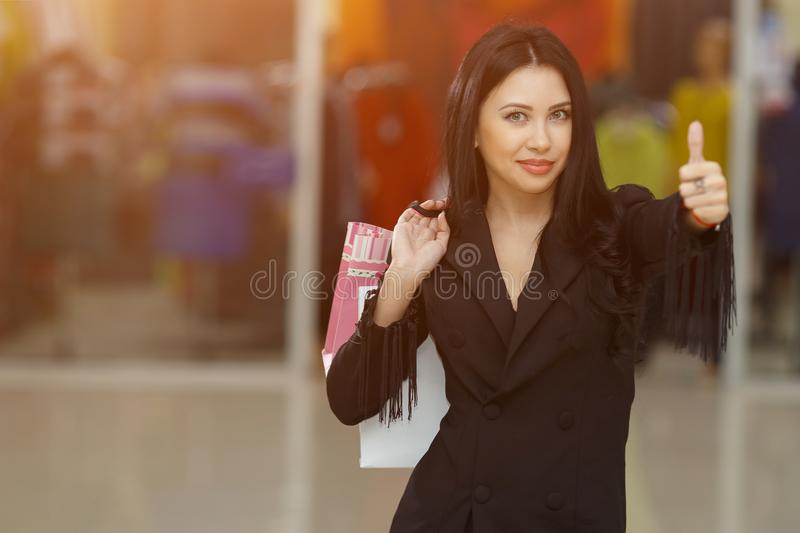 Shopping time, woman at mall showing thumbs up stock images