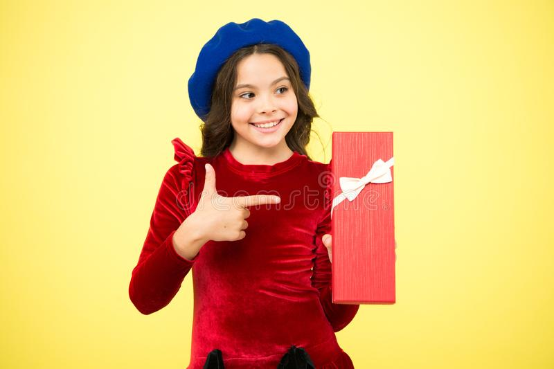 Shopping to find the perfect gift. Cute kid enjoying shopping. Little girl after shopping for gift. Small child holding stock images