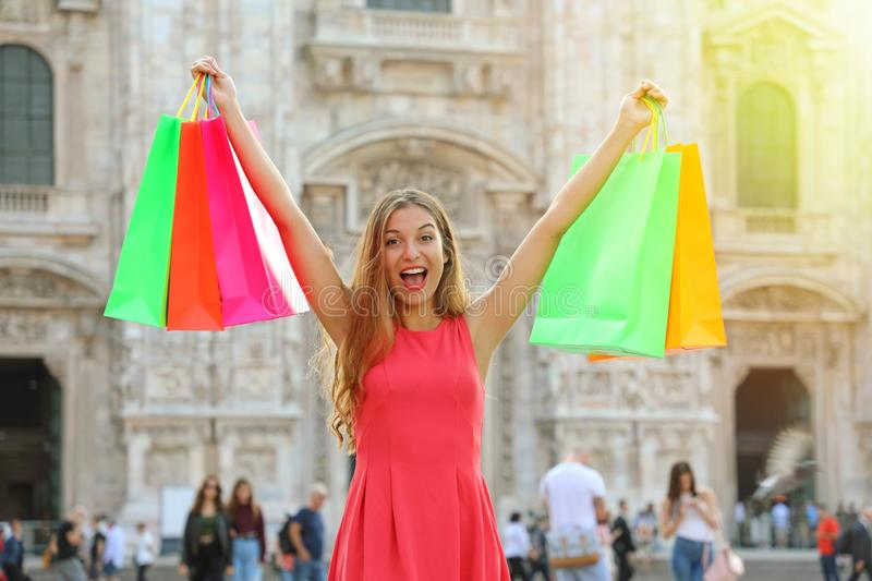 Shopping and tourism concept. Euphoric beautiful woman with shop royalty free stock photography