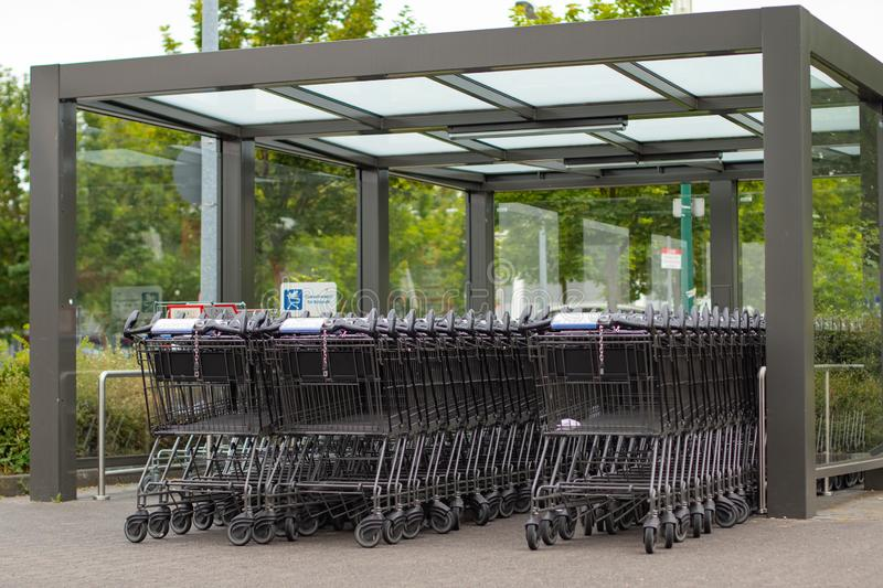 Shopping trolley from ALDI South under a roof stock photography