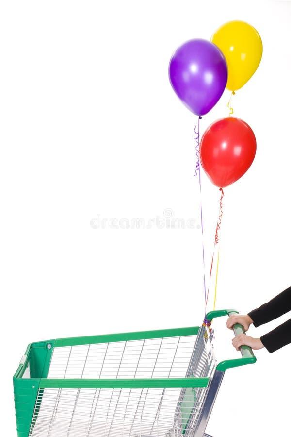 Shopping Trolley With Ballons Stock Photos