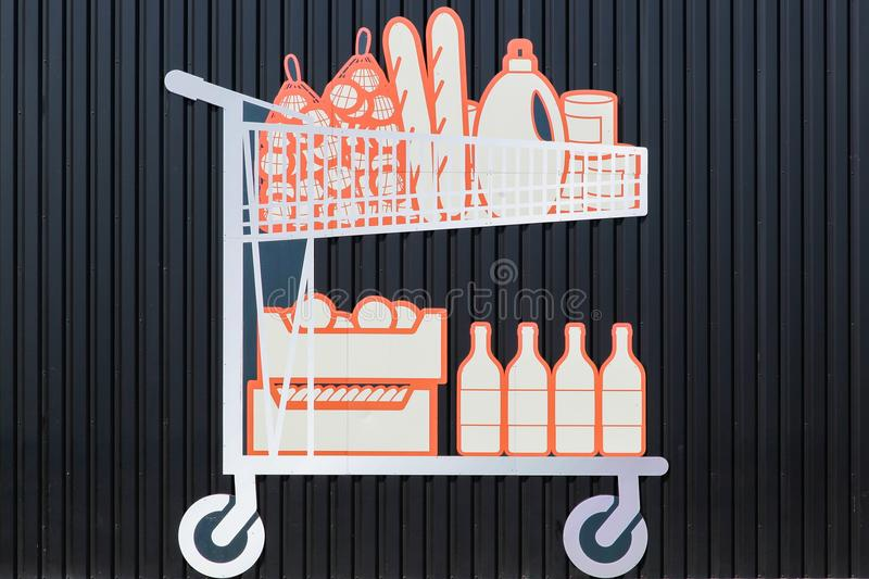 Shopping trolley. On a black wall stock illustration