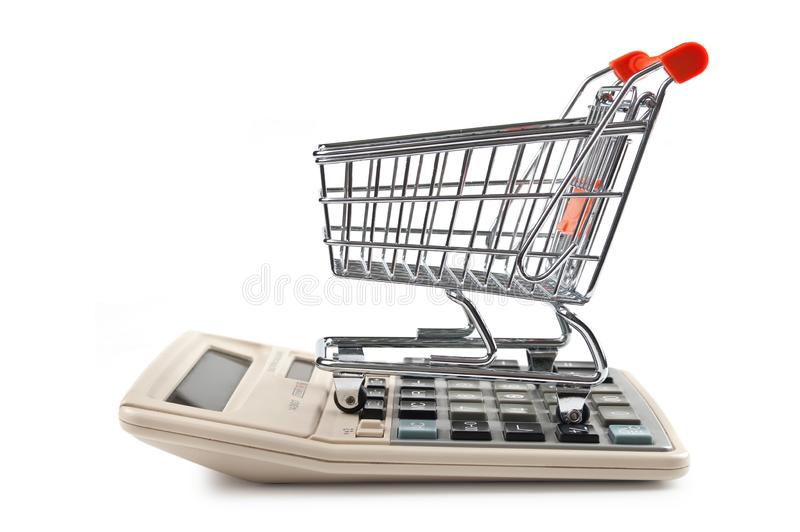 shopping trolley and calculator royalty free stock images