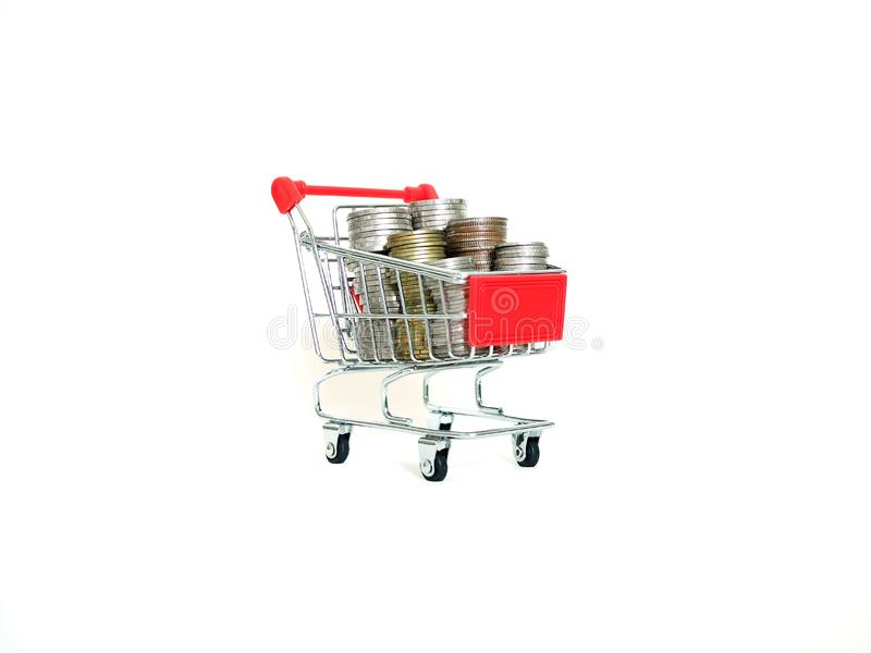 Shopping trolley with coins isolated on white background. concept of save money, cash back when shopping or money spend in shops.  royalty free stock image
