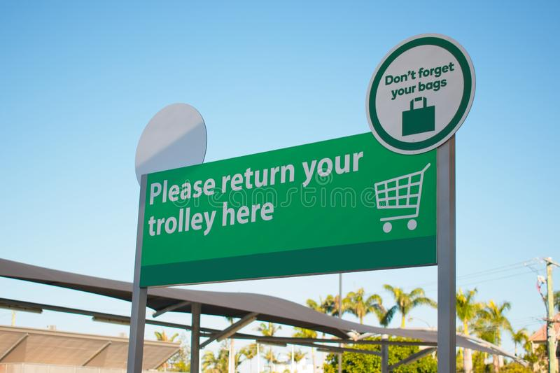 Shopping trolley return bay. Please return your trolley here royalty free stock photos