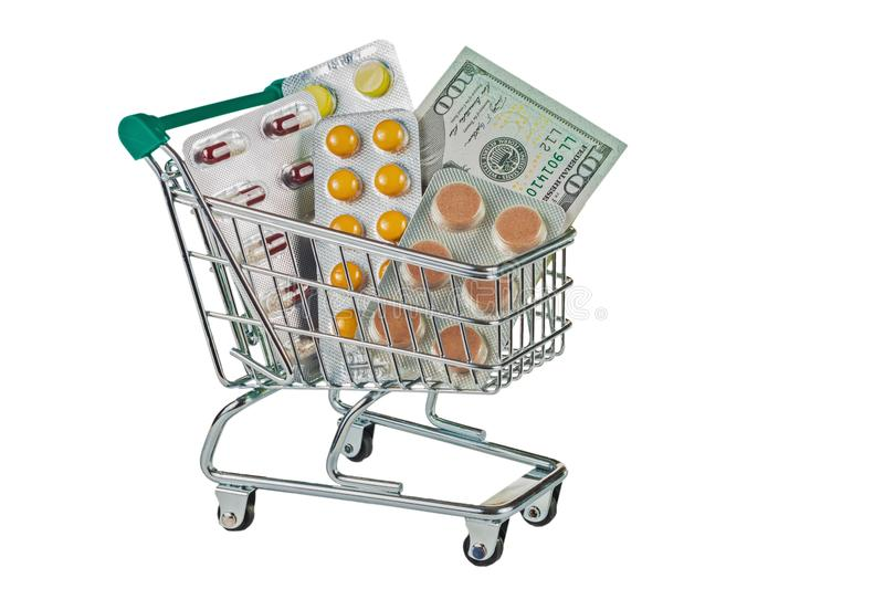 Shopping trolley with medicaments. Shopping trolley with tablets. Symbol of saving money when buying medicaments. Isolated on white background royalty free stock photography