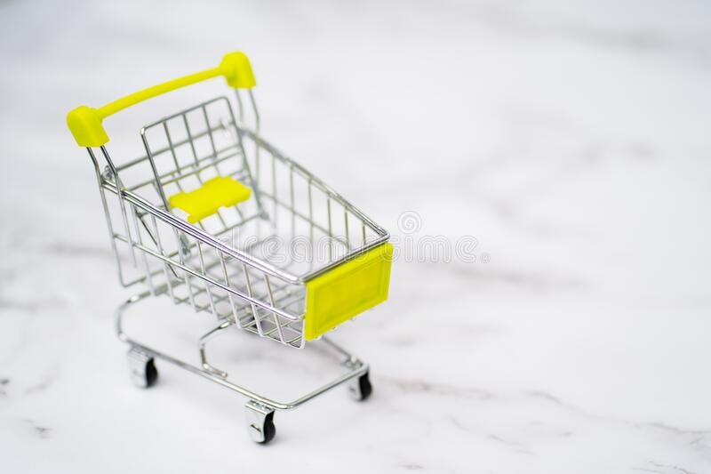 Shopping trolleys on light background stock photography
