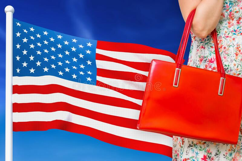 Shopping in United States of America. Woman with red leather bag. Is shopping in shopping center stock images