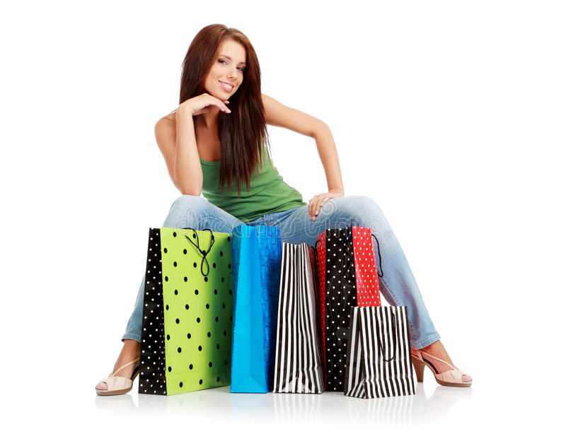 Shopping woman. Isolated over white background stock photo