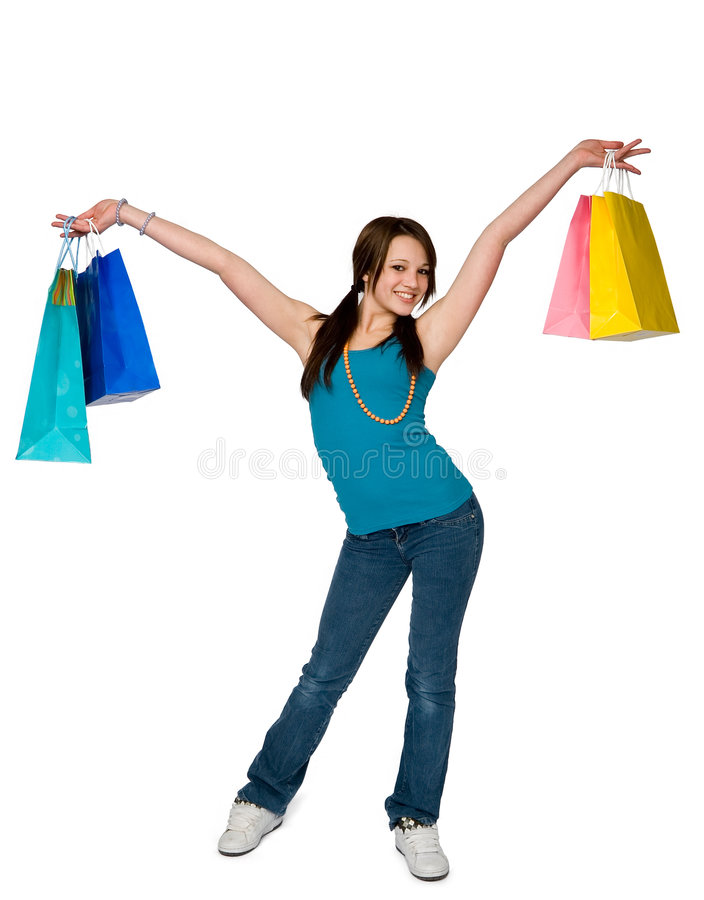 Shopping woman. Full length of teenage girl standing holding gift bags stock photography