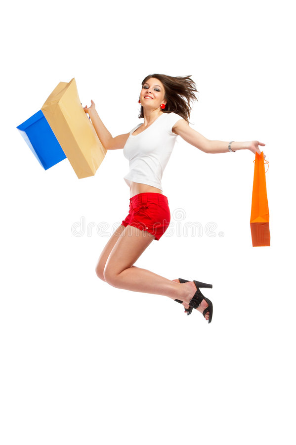 Shopping Woman. Beautiful woman with casual outfit and shopping bags in her hands over white background stock image