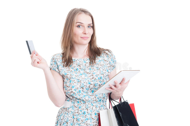 Shopping woman with bags choosing online payment stock images