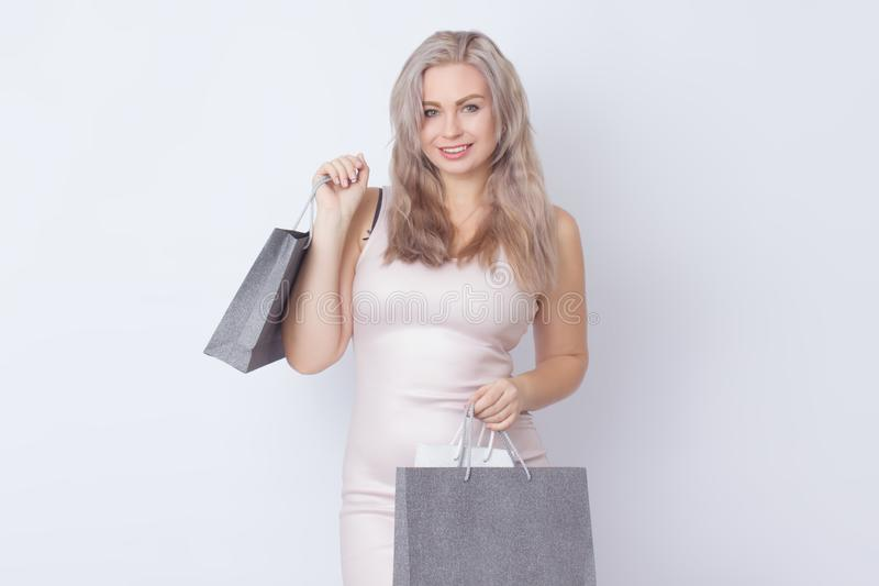 Shopping woman with bags in her hands stock photos