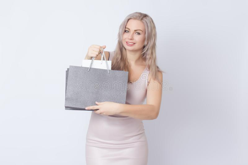 Shopping woman with bags in her hands royalty free stock photography