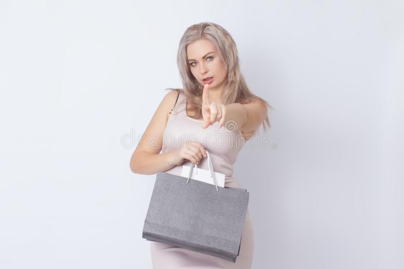 Shopping woman with bags in her hands stock photography