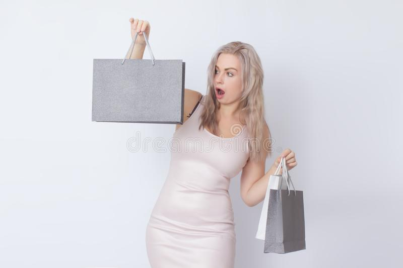 Shopping woman with bags in her hands stock images