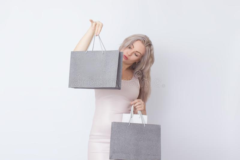 Shopping woman with bags in her hands royalty free stock images
