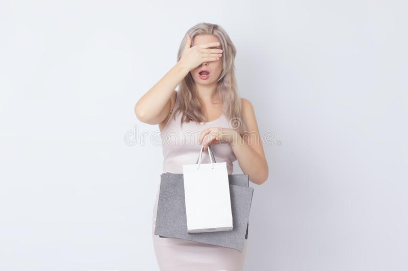 Shopping woman with bags in her hands royalty free stock photos