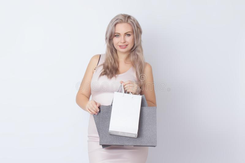 Shopping woman with bags in her hands stock image