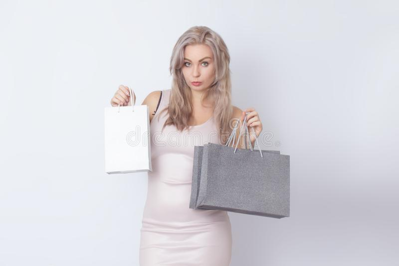 Shopping woman with bags in her hands royalty free stock photo