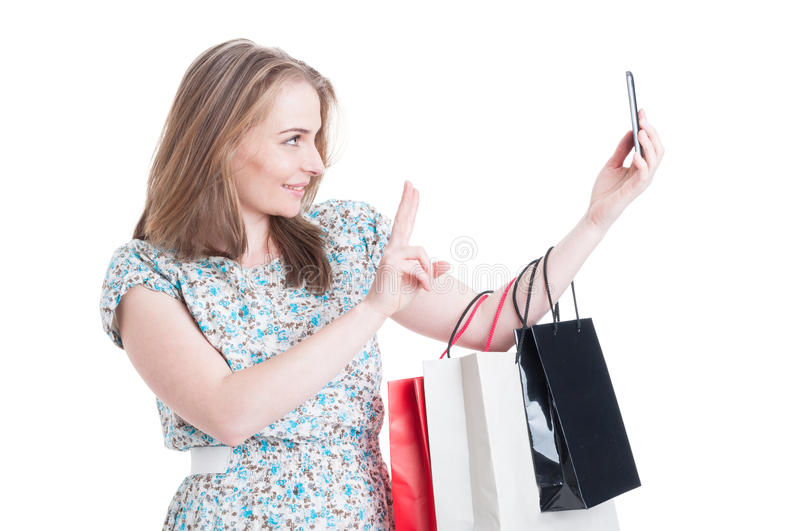 Shopping woman with bags taking self portrait stock image
