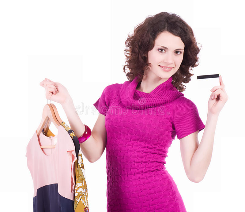 Shopping woman with credit card and new dresses