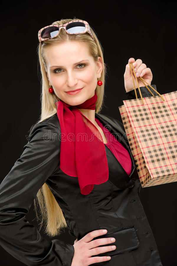 Shopping woman fashion happy bag. Portrait happy fashion woman in designer clothes with shopping bag royalty free stock photo