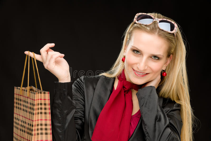 Shopping woman fashion happy bag. Portrait happy fashion woman in designer clothes with shopping bag royalty free stock image