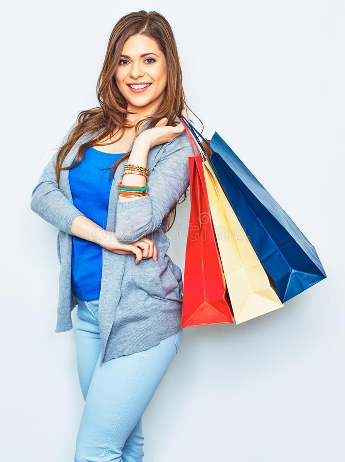 Shopping woman holding bag on shoulder. Smiling pretty girl stock photos