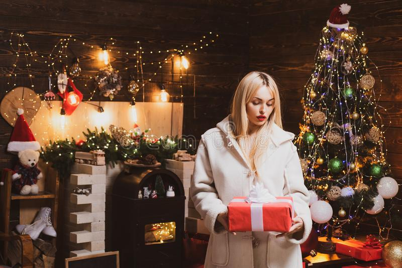 Shopping woman holding gift boxes. Christmas make-up and hairstyle. Fashion and beauty make-up and hairstyle for stock images