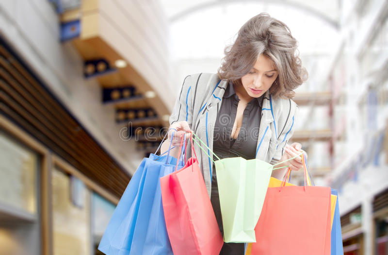 Shopping woman in mall. With bags