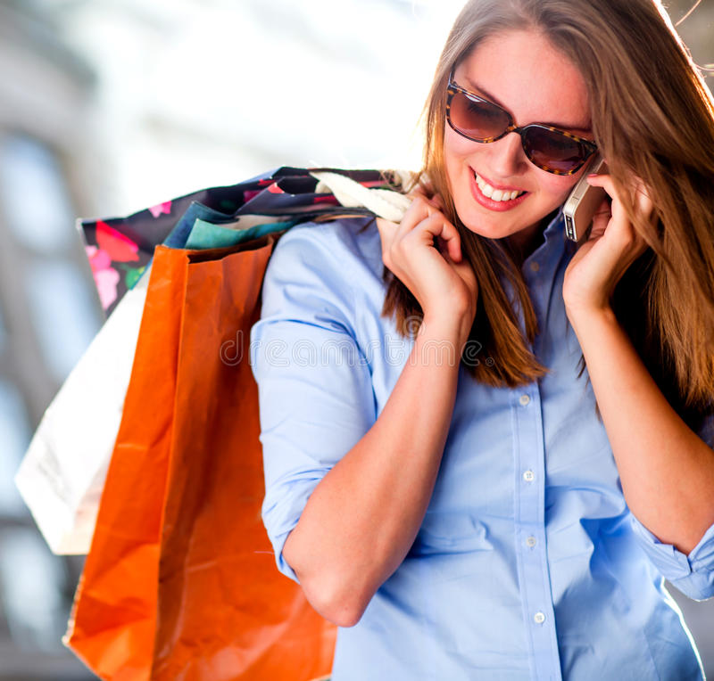 Download Shopping Woman On The Phone Stock Image - Image of bags, buyer: 26674389