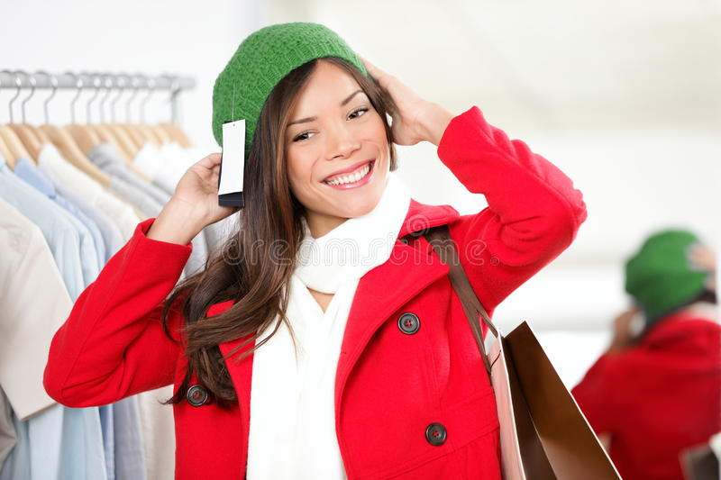 Shopping woman at store trying on a hat royalty free stock images