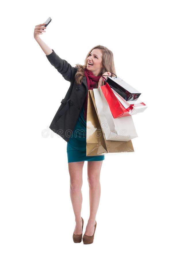 Shopping woman taking a selfie. With the shopping bags stock photo