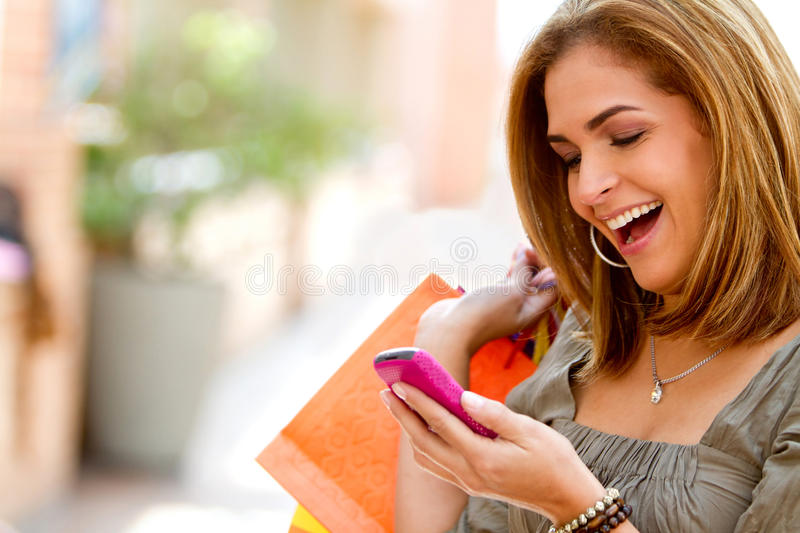 Download Shopping woman texting stock photo. Image of communications - 18805278