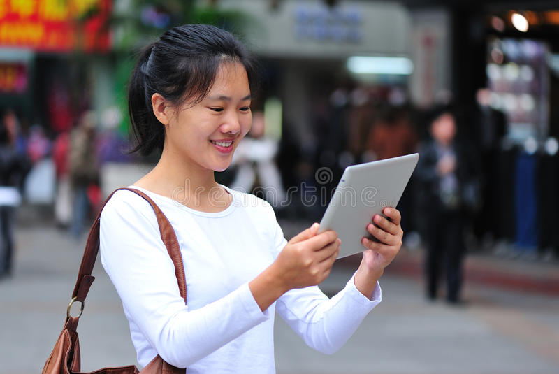 Shopping woman using tablet