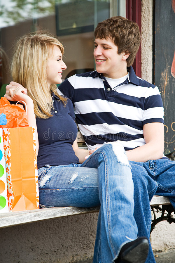 Shopping young caucasian couple royalty free stock photo