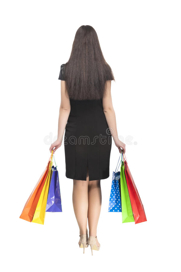 Shoppingbegrepp: Tillbaka Caucasian brunettkvinna arkivfoto