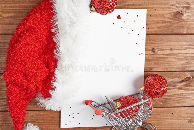 Shoppinglista för jul arkivbild