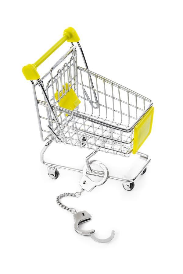 Shoppingvagn och handbojor royaltyfri fotografi