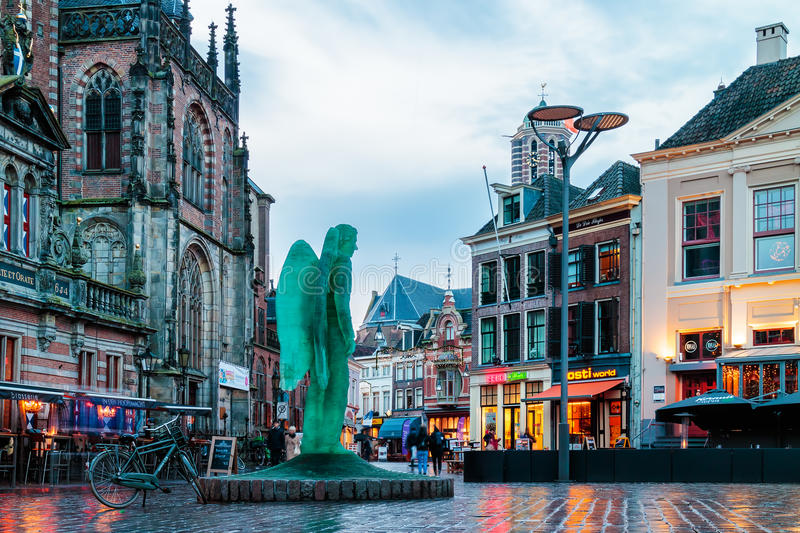 Shops, bars and restaurants on the Grote Markt square in Zwolle, The Netherlands. ZWOLLE, THE NETHERLANDS - DECEMBER 7, 2016: Shops, bars and restaurants with royalty free stock photography