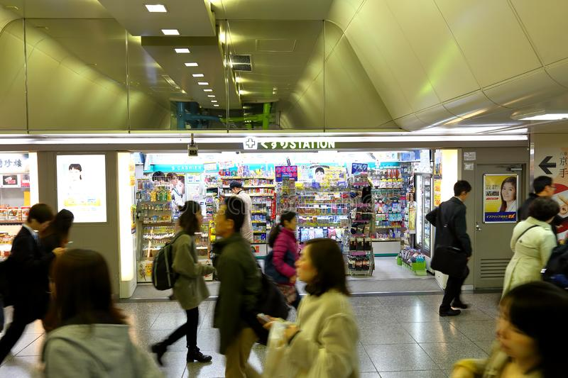 Japan: shops. Shops in 1 of the many train stations in Tokyo. Large crowd passing by royalty free stock images
