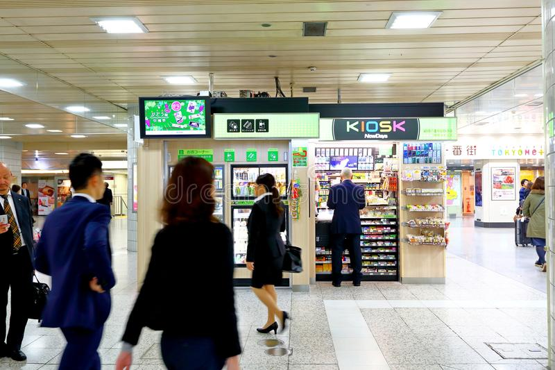 Japan: shops in train station. Shops in 1 of the many train stations in Tokyo.Large crowd passing by royalty free stock photo