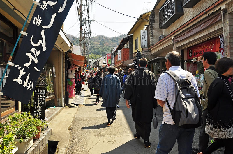 Shops before path of Phylosophy in Kyoto. KYOTO - APRIL 09: Tourists visit Path of Philosophy on April 09, 2014 in Kyoto, Japan. It is a pedestrian path that royalty free stock photography