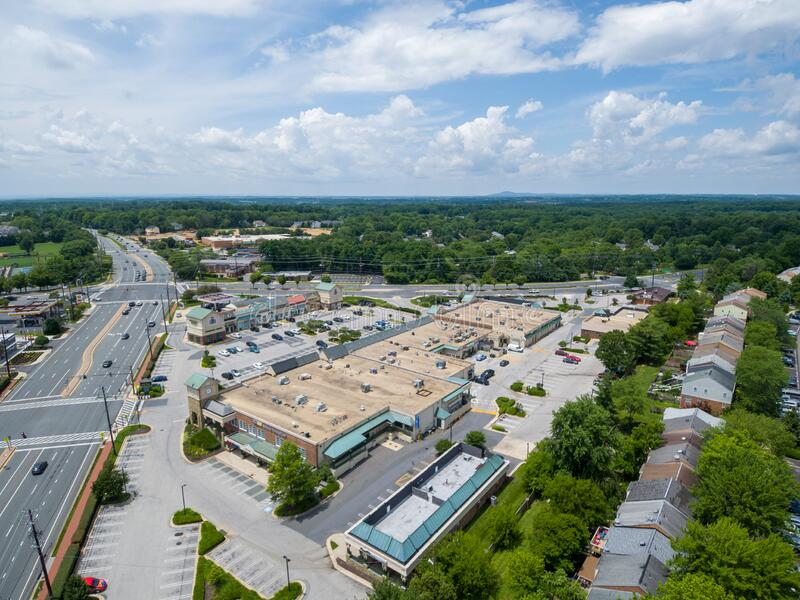 Shopping center during Covid-19 pandemic. Gaithersburg, Md. - June 28, 2020: Aerial view of The Shops at Potomac Valley in the Quince Orchard area of royalty free stock photos