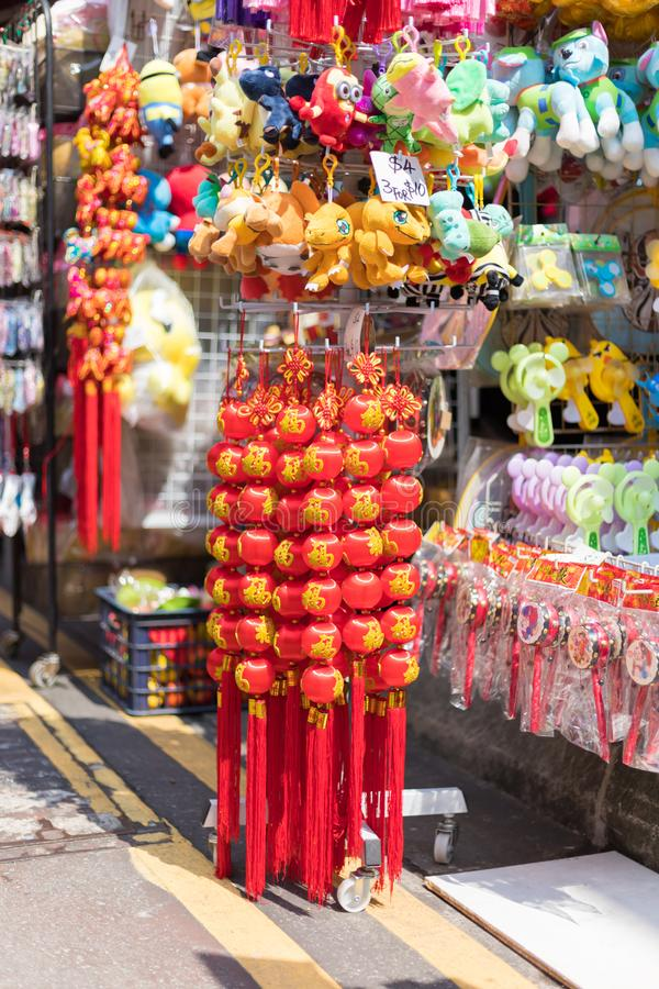 Shops sale souvenirs, gift and decoration. Lucky ornaments at street market in Chinatown, Singapore. Singapore city, Singapore - 3 March 2018: Shops sale royalty free stock image