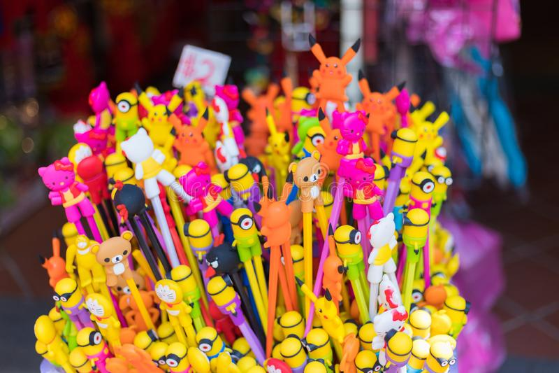 Shops sale souvenirs, gift and decoration. Lucky ornaments at street market in Chinatown, Singapore. Singapore city, Singapore - 3 March 2018: Shops sale royalty free stock photography